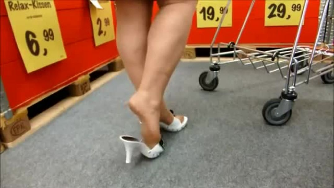 Shopping in white Mules and Pantyhose
