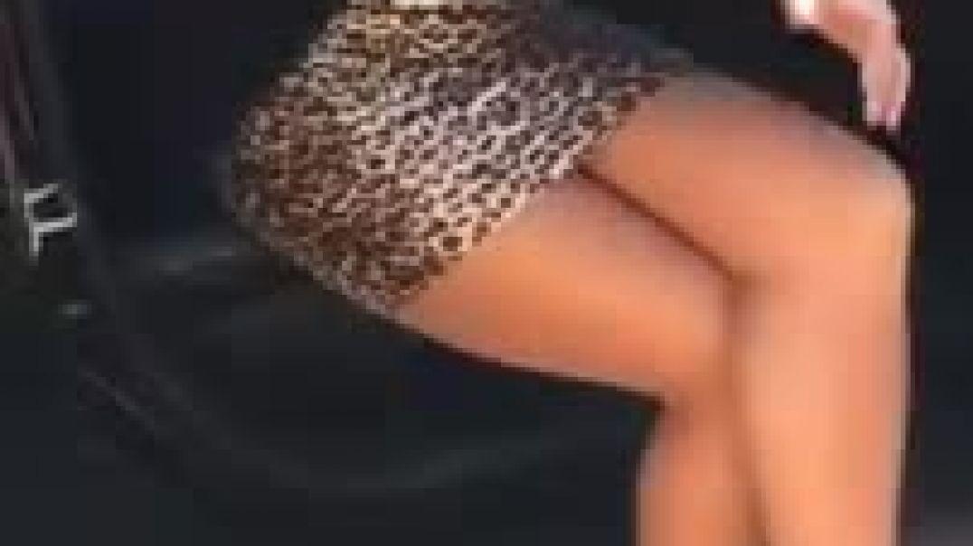 Carrie laChange - Leopard skirt, high heels