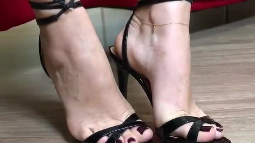 Putting on black strappy Highheels