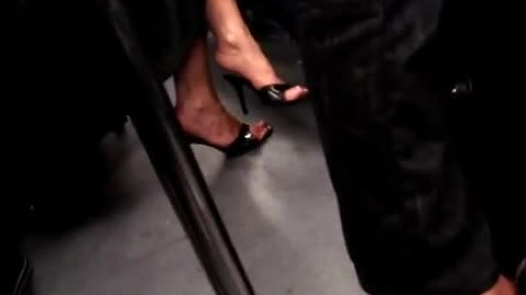 Dior mules (or slides) in the subway