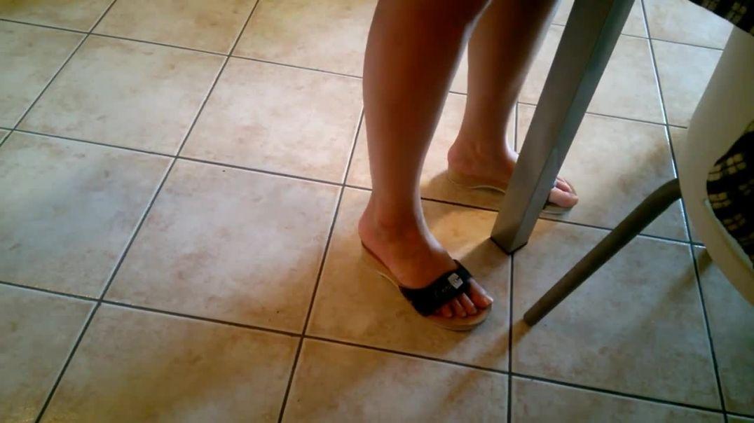 Woman in black scholls sandals in her kitchen